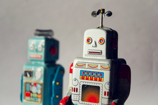 Angry vintage tin toy robots, artificial intelligence, robotic delivery concept